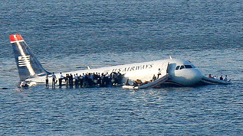 Many passengers huddled onto both wings, while they awaited rescue.