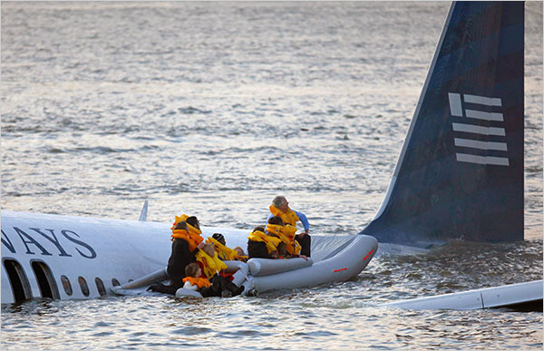 The last few passengers await rescue, as the aircraft slips below the water.
