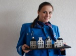 Since the 1950's KLM has presented all of its World Business Class passengers with a unique gift a Delft Blue miniature traditional Dutch house. Each miniature depicts a real Dutch house. Every year on October 7, the airline celebrate the anniversary of KLM's founding in 1919 by presenting a new house.