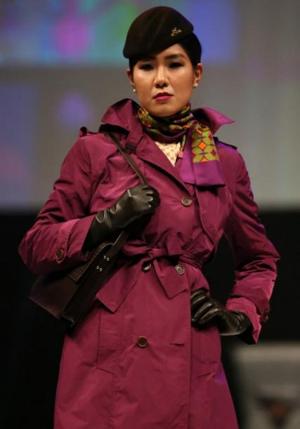 """A classic trench coat adds a sense of catwalk drama....."""