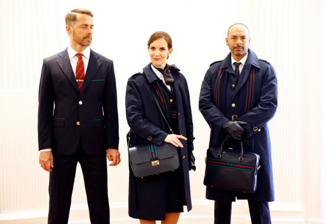 Alitalia airline crew members pose with new uniforms during the official presentation of Alitalia's new Alberta Ferretti-designed uniforms inMilan